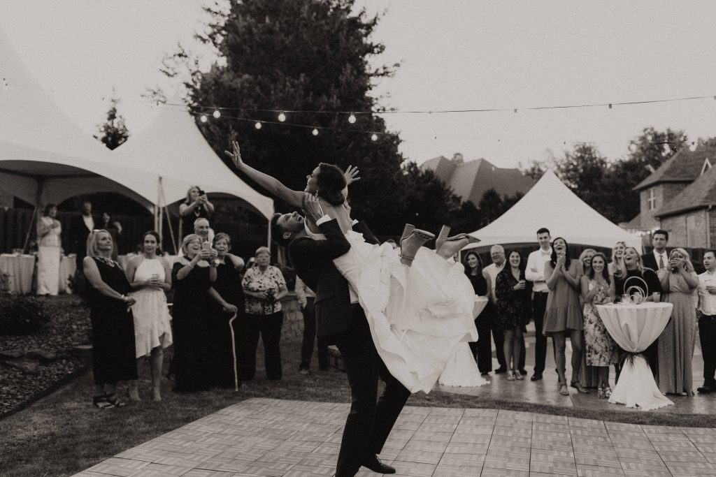 Groom lifting his bride during their first dance.