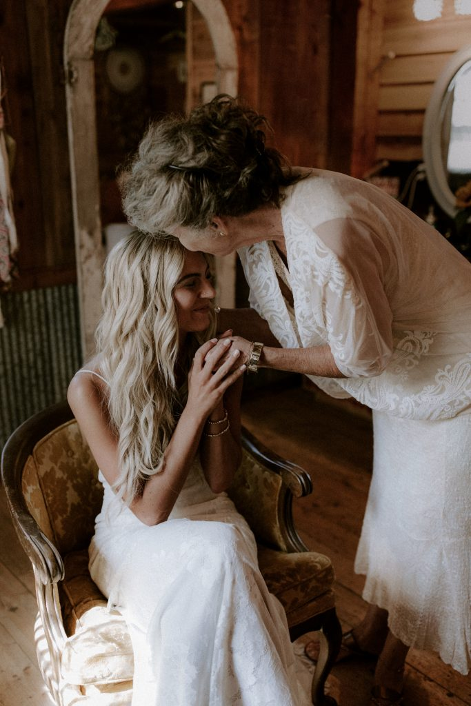 Bride being kissed by her grandmother.